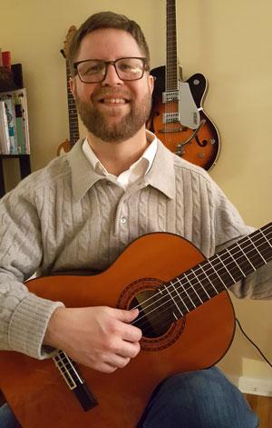 Chris with guitar